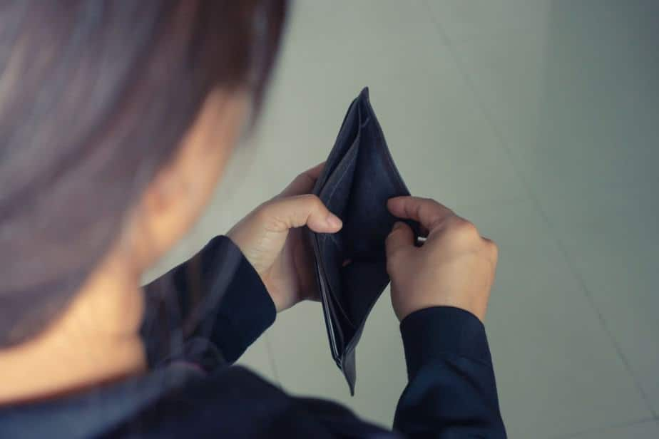 woman open wallet with no money inside