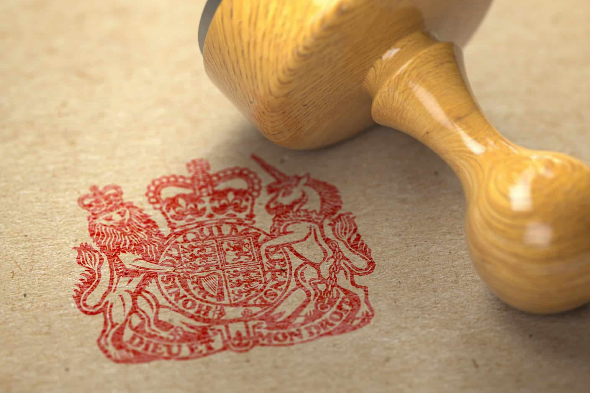 United Kingdom coat of arms stamp with rubber stamp on craft pap